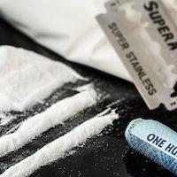 Cocaine razor blade rolled