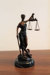Lady Justice, a woman who is symbol of the law and courts