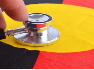 Medical stethoscope on the Aboriginal flag