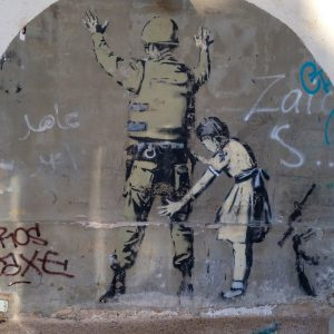 Graffiti of child searching police officer
