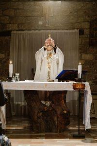 Catholic priest preparing communion