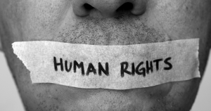 human rights taped over man's mouth