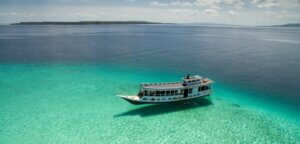 A boat in the waters off the village of Bau Bau in South East Sulawesi, Indonesia