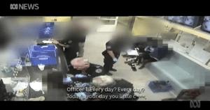screen shot of NT police assaulting Aboriginal teenage boys