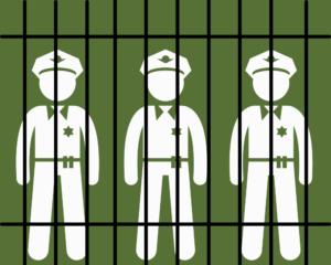 Police officers behind prison bars