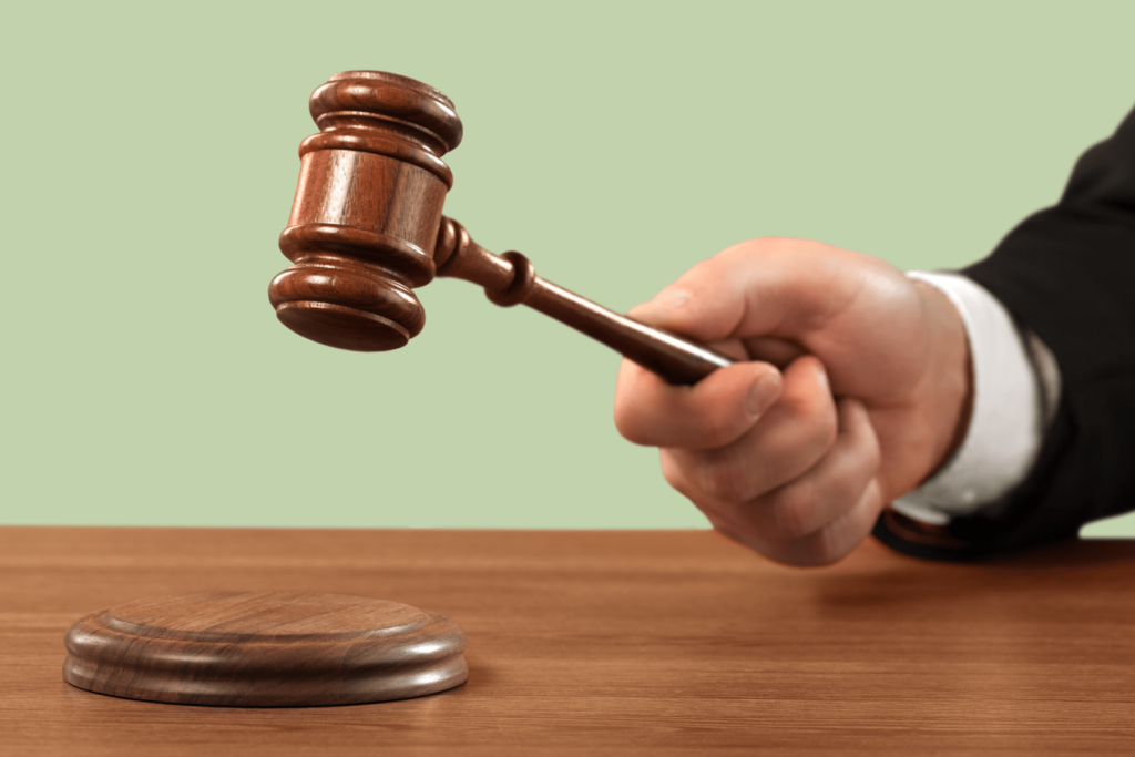 justice symbolized by the gavel of a judge or magistrate