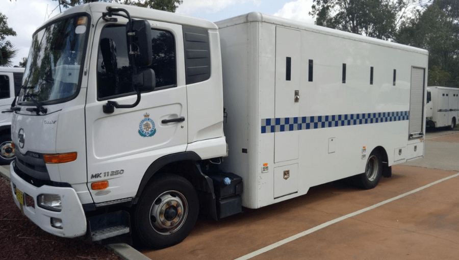 prison transfers occur usually in Corrective Services vans