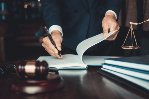 Lawyer writing No Win, No Fee cost agreements